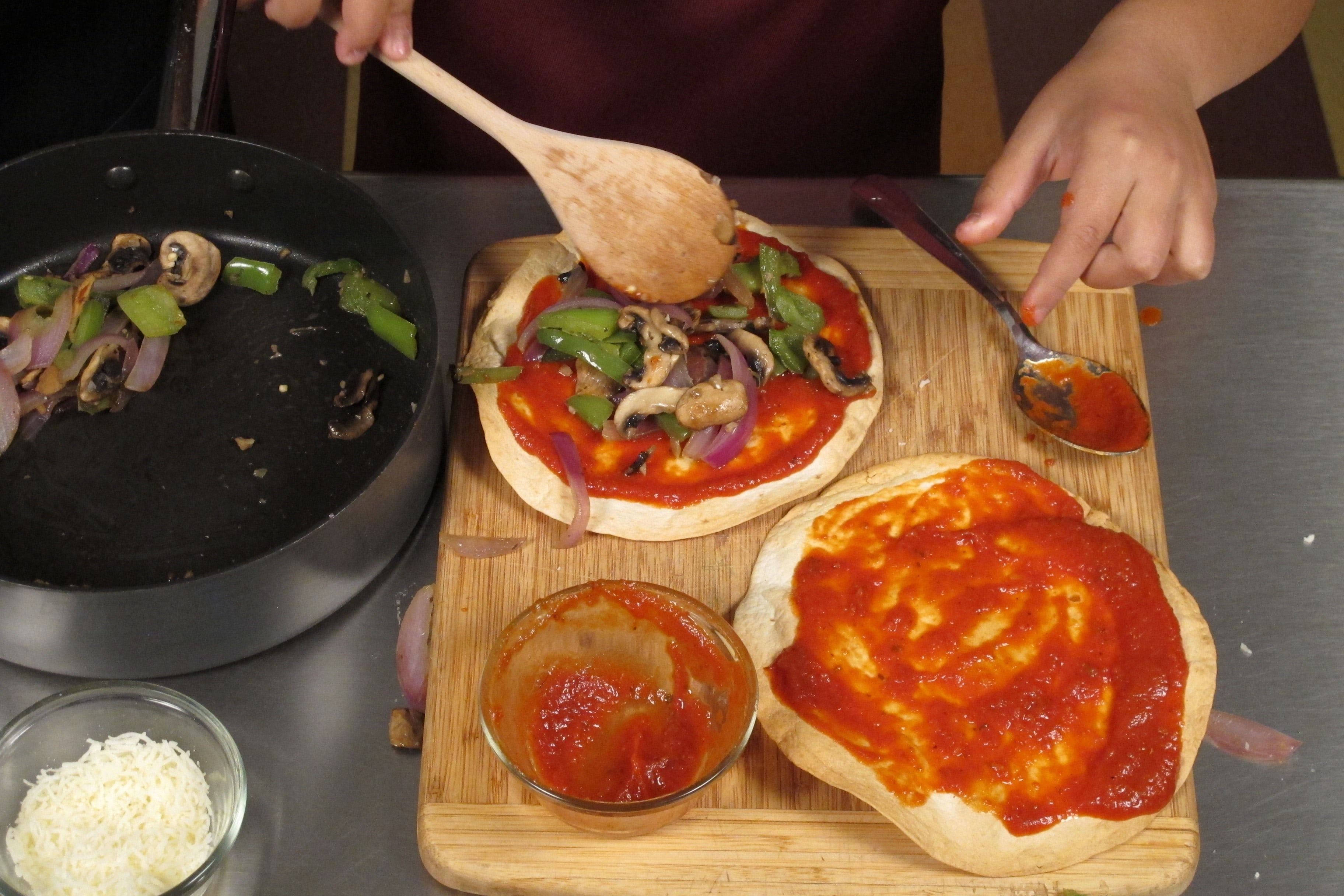 Spread 2 tablespoons of tomato sauce and a bit of the vegetable mixture onto each tortilla crust.